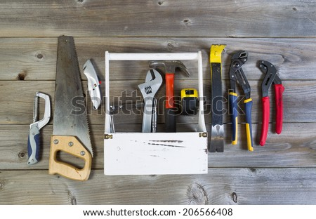 Over head view of basic home repair tools and holder on rustic wooden boards - stock photo