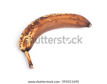 Over ripe banana isolated on white background - stock photo