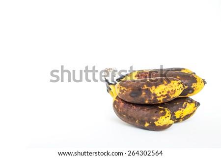 over ripe, overripe, over-ripe bunch of bananas isolated on a white background , ripe golden banana - stock photo