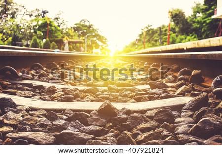 over sunlight, Hua Hin  train station-Thailand, railway or railroad tracks for train transportation,  retro tone [blurred and soft focus background] - stock photo