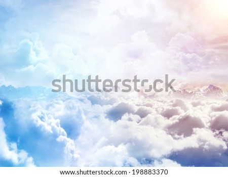 Over the Clouds. Fantastic background with clouds and mountain peaks - stock photo