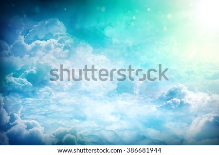 Over the Clouds. Fantastic background with clouds and sunlight beams - stock photo