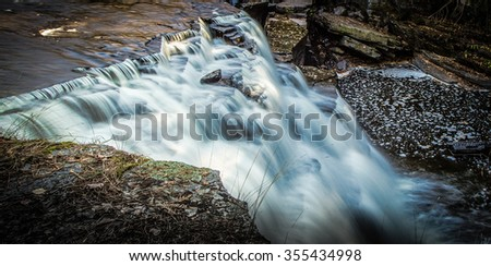 Over The Edge Of Canyon Falls. The precipice of Canyon Falls in Michigan's wild and beautiful Upper Peninsula. - stock photo
