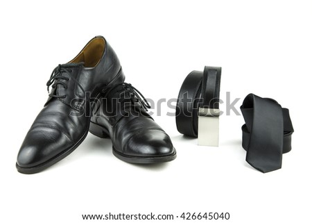 over-white portrait of black accessories for man / elegance in black - stock photo