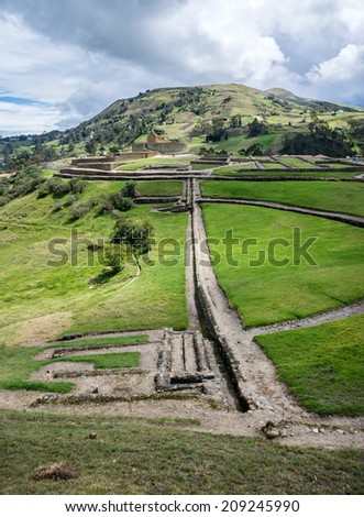Overall view of the ancient Inca ruins of Ingapirca, Ecuador, on an overcast day. - stock photo
