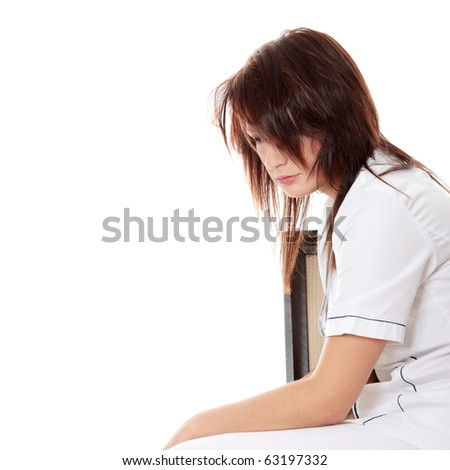 Overburdened female doctor in the stress , isolated on white - stock photo