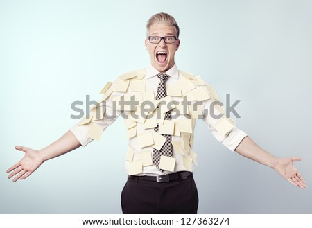 Overburdened shouting businessman covered by many empty yellow stickers with space for text, isolated. - stock photo