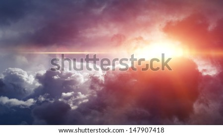 Overcast day sun beam through the clouds - stock photo
