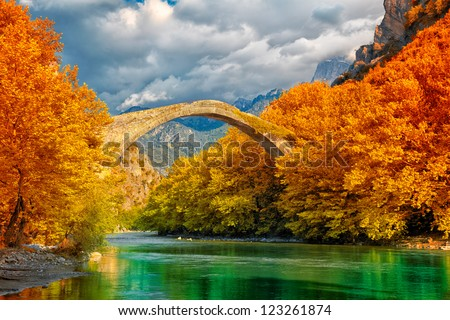 Overcast landscape of Konitsa bridge and Aoos River, Greece. - stock photo
