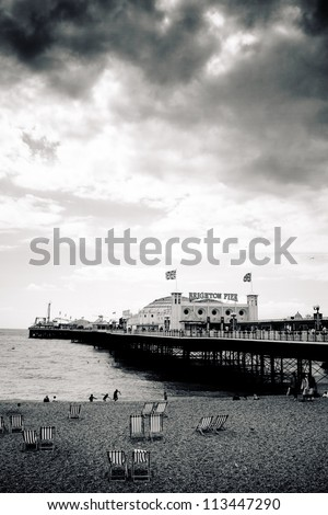 Overcast sky above Brighton Palace Pier, high contrast - stock photo