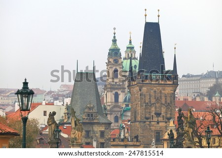 Overcast sky above Gothic towers and old churches seen from the Charles Bridge, Prague, Czech Republic - stock photo