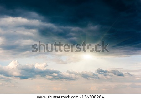 Overcast sky before storm. Dark ominous clouds at sunset. - stock photo