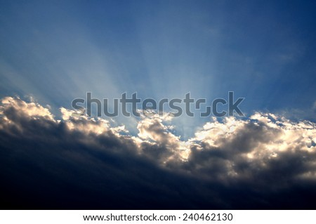 Overcast sky. The sun has gone behind a cloud - stock photo