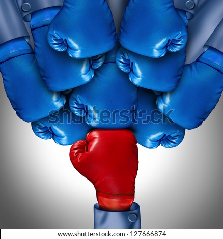 Overcoming adversity and conquering challenges as a group of blue boxing gloves ganging up on a single red glove as a business symbol of difficult competition environment, - stock photo