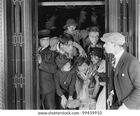 Overcrowded elevator - stock photo