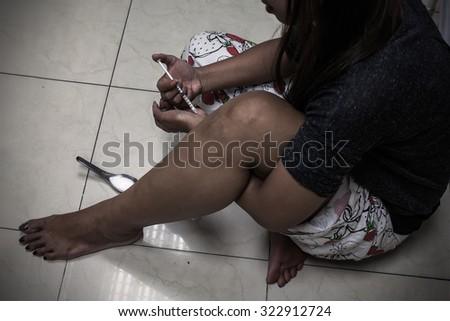 overdose asian female drug addict hand, drugs narcotic syringe in action - stock photo
