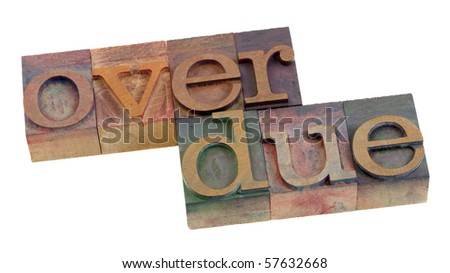overdue word in vintage wooden letterpress printing blocks, stained by color ink, isolated on white