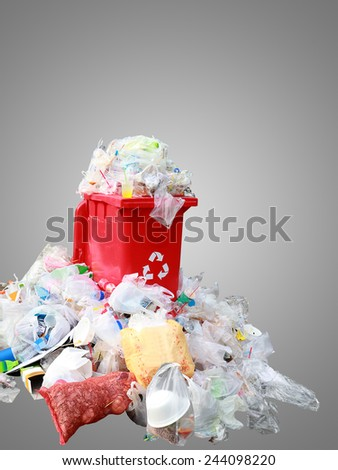 Overflowing garbage red bins waiting for official action against waste plastic that caused the man to put food sorting, and then left to recycle. - stock photo