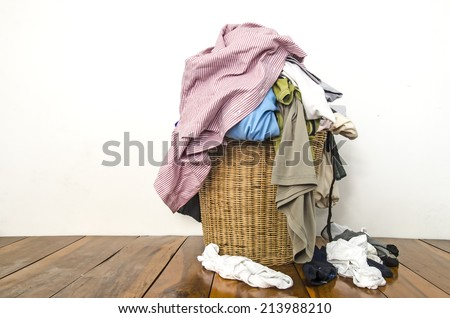 Overflowing laundry basket - stock photo