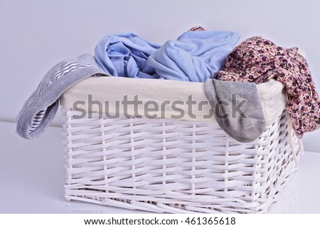 Overflowing laundry basket. Household chore concept