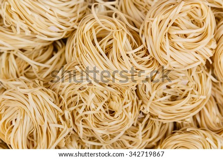 Overhead close up view of coiled, dried noodles