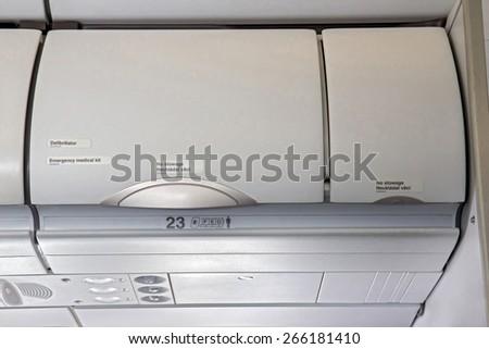 Overhead compartment -  airplane cabin interior - stock photo