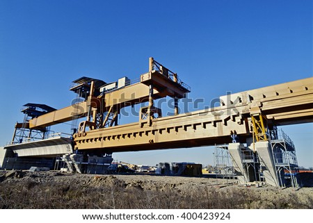 Overhead crane for installation of viaduct sections in function