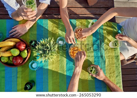 overhead drinks party friends eating snacks - stock photo