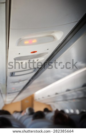 Overhead NO SMOKING sign inside an airplane