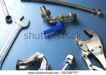 overhead of an essential tool kit for plumber / set of plumber tools