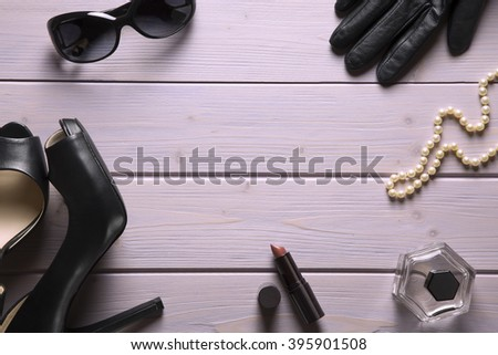 overhead of essential accessories for the elegant woman / it's a metter of style - stock photo