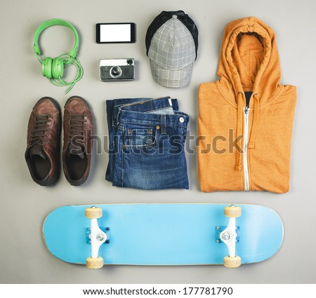 Overhead of essentials casual boy./ Outfit of skater man on grey background.