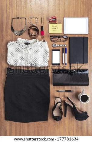 Overhead of essentials elegant woman./ Outfit of business woman in office.