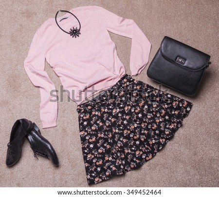 Overhead of essentials of a modern woman.Outfit of casual woman. - stock photo