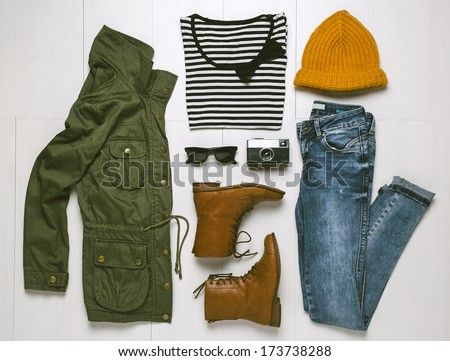 Overhead of hipster woman essentials. Outfit of casual woman.  - stock photo