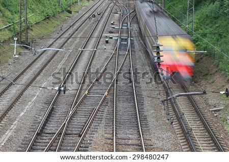 Overhead of railroad with blurry train in motion