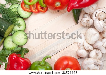 Overhead of vegetables around the corners of the frame with space for text