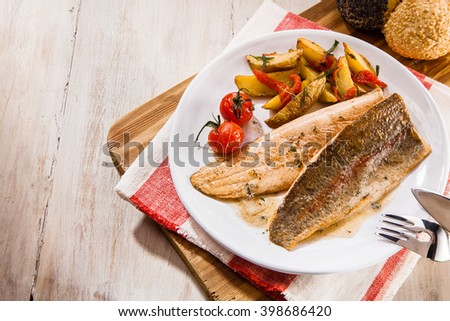 Overhead or high angle view on salmon trout fish fillet. Top down view of delicious barbecued fish meal on rustic background with copy space. - stock photo