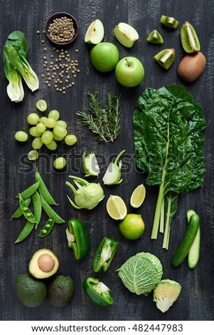 Overhead series of fresh organic raw green colored vegetables, part of a food collection set