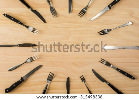 overhead shot image of forks and knifes background - stock photo
