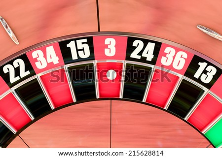 Overhead shot of an American roulette wheel winning number three - stock photo