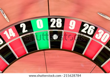 Overhead shot of an American roulette wheel winning number twenty eight - stock photo