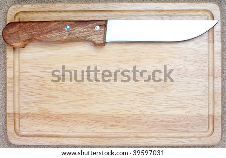 Overhead shot of bread board and nice and clean knife with space for text, menu or design - stock photo