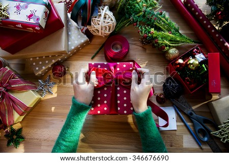 Overhead shot of Christmas presents and wrapping papers - stock photo