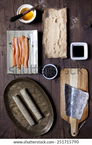 overhead shot of ingredients for preparing fried hosomaki sushi on table - stock photo