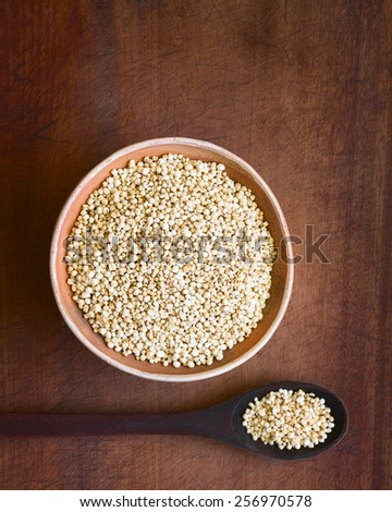 Overhead shot of popped white quinoa (lat. Chenopodium quinoa) cereal in bowl, photographed with natural light (Selective Focus, Focus on the popped quinoa in the bowl) - stock photo