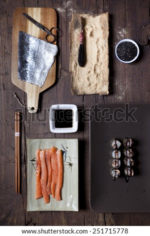 overhead shot of prepared hosomaki sushi and ingredients on table - stock photo