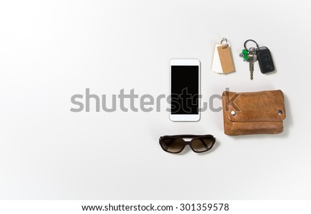 overhead shot of woman stuff isolated on white background with space on the left - stock photo