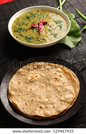 Overhead view-Dal palak,Lentil spinach curry dish served with chapathi.