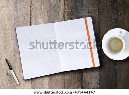 Overhead view note book and empty coffee on wood table background
